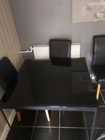Black glass dinning table with 4 chairs