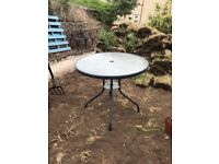 Black and glass garden table