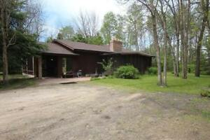 Well maintained bungalow on 14.77 acres just minutes from Wpg!