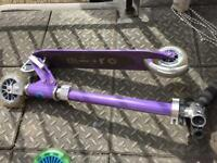 Purple micro scooter