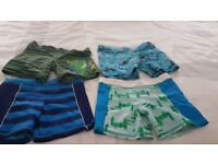 Four pairs of brand new swim trunks age 6-7