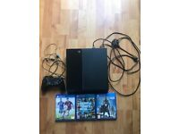 PlayStation 4 in perfect condition, comes with 3 games
