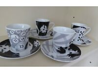 A set of 4 expresso cups and saucers in a 'casino' theme