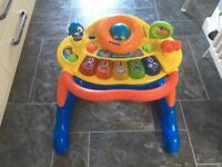Baby walker with detachable play section