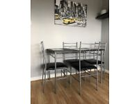 Black and silver dining table and chairs