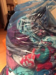 Two bags of girls clothing and shoes