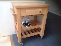 Sturdy SERVUS solid wood wine storage trolley on castors.