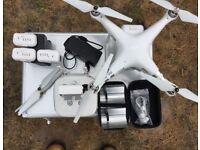 DJI Phantom 3 Advanced with 4 genuine Dji batteries, metal security case, soft backpack