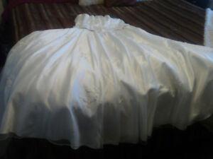 Beautiful white satin strapless wedding gown