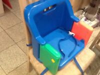 Portable/foldable/travel booster seat for dining chair with straps to secure to chair-folds compact