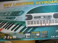 Casio LK 70 S keylighting keyboard with stand