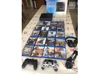PS4 500gb. 2 Duo-Shock controllers/headsets & 20 games