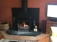 Log Burning Fire, open fronted fire and 5-6 m of double insulated flue. 2 bends and roof cowl.