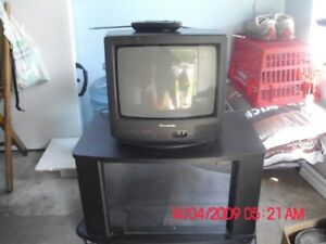 Panasonic TV with stand and remote