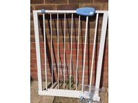 White metal pressure stair / doorway gate