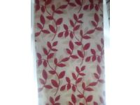 Red and beige eyelet curtains.