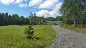 1990 mini home and land for sale