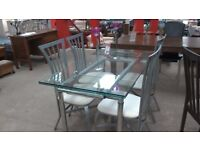 Lovely glass dinning table with 4 chairs
