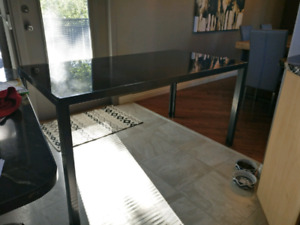 Table: steel frame with tinted black glass top