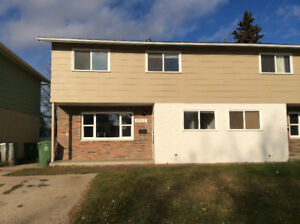Large duplex for rent with fenced, private, mature backyard.