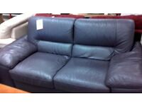 Lovely purple leather sofa with footstool.
