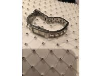 DKNY ladies silver watch with diamonds on the wrist band