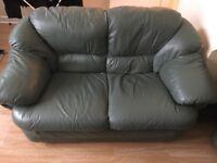 Green 2+3 seater sofas