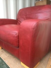Lovely red leather arm chair and foot stool