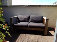 Hand-built outdoor seating bench sofa with cushions