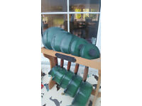 Set of 5 used used green Cousances cast iron saucepans with a stand