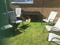 Garden glass top table and 6 chairs