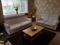 Cream Leather 3+2 seater Sofa made by Natuzzi.