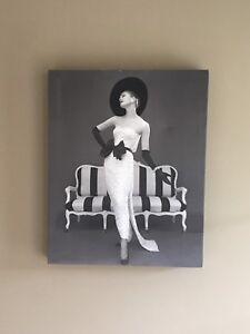 A black and white decorative wall piece