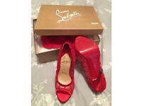 Red satin mesh Christian Louboutin heels. UK 5