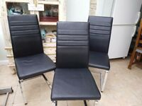 Three black Leather designer chairs .ideal for indoors or outdoors ..Even used as office chair