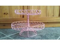 Two tier pink cake stand with heart decoration