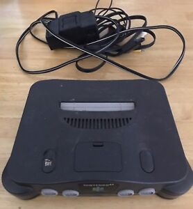 Black N64,3 Controllers and Games.