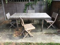 Extending garden table, 4 chairs and cream parasol