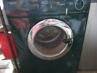 SERVIS TUMBLE DRYER GREEN IN COLOUR.