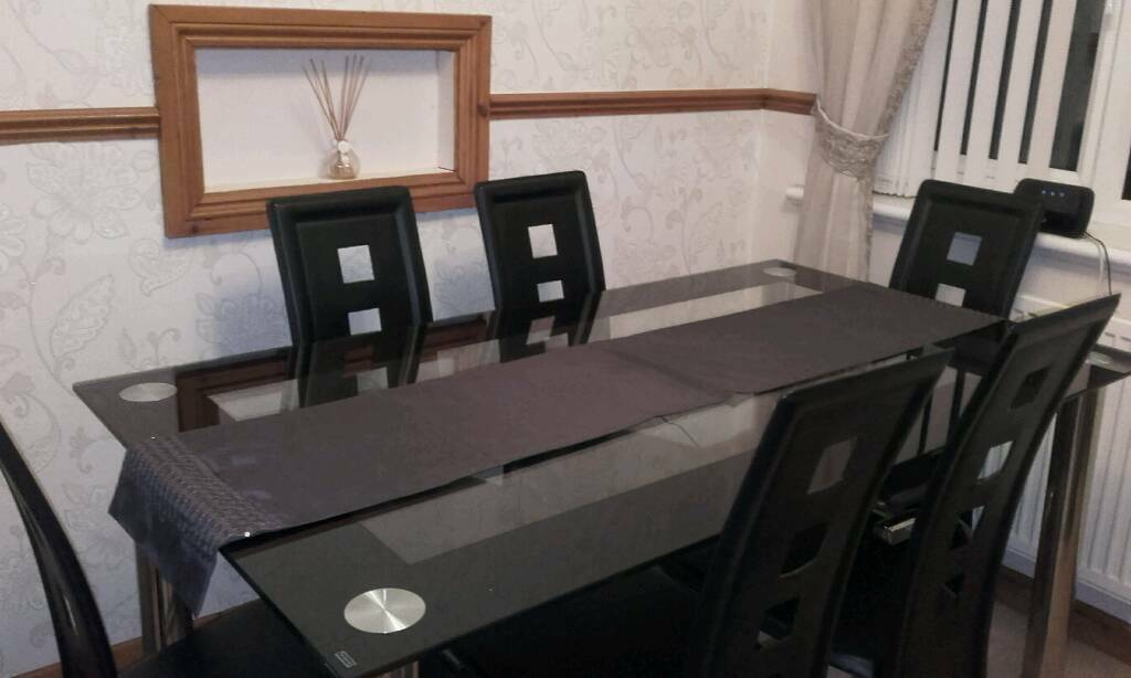 Table and chairsin Risca, NewportGumtree - For sale .Glass top table and 6 black leather look chairs .Ex condition