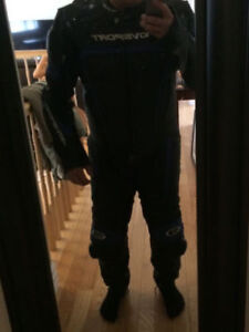 Track suit, gloves, boots and helmet for sale