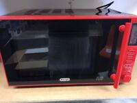 Delonghi 900w red Brand new in the box microwave with instruction