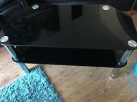 Black glass TV stand with matching coffee table