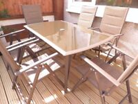 Garden table and six textilene chairs.