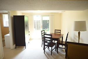 Walk out basement with bedroom/dining/living area.