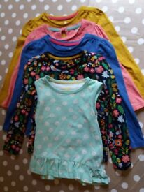 4 x girls long sleeved tops and 1 x short sleeved top. Age 18-24 months