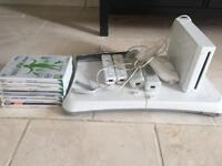 Wii console, wii fit board, 7 games and controllers