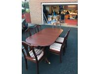 Mahogany dining room table and chairs- extendable and collapsable