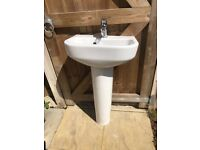 2 Bathroom sinks and pedestals