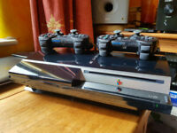 PS3 Console 2 gamepads/ 1 dualshock and 29 games